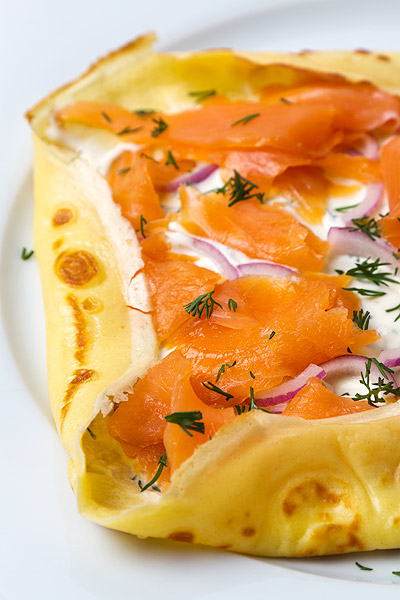 Pancake with salmon and sour cream