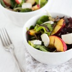 Green salad with grilled peaches and goat cheese